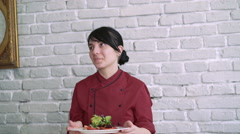 A cook showing salad on a plate 4k - stock footage