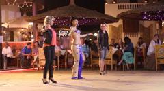 Beautiful woman dancing outdoors at night Arkistovideo