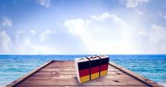 Composite image of german flag suitcase - stock illustration