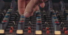 Sound engineer working in a recording studio - stock footage