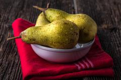 dewy fresh pears in a bowl - stock photo