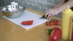 Close-up of chef chopping a cucumber with red pepper on cutting board 4k Stock Footage