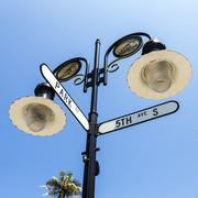 historical street sign in Naples, Florida under blue sky - stock photo