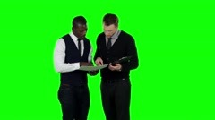 Businessmen consider the documents. Green screen - stock footage