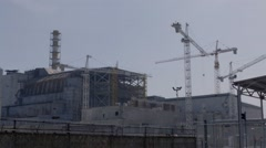 Working cranes near destroyed reactor at Chernobyl nuclear power plant - stock footage