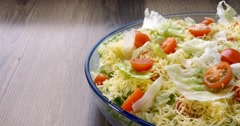 Beautiful colourful caesar salad with dressing croutons and parmesan cheese, hea - stock footage