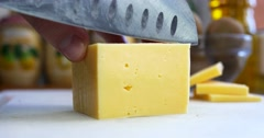 Man cutting piece of cheese - stock footage