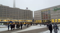 People at Alexanderplatz shopping center, cold snowy winter day, Berlin Stock Footage