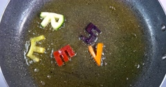 Stir-frying mixed alphabet letters, word Serve - stock footage