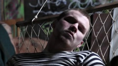 Prisoner resting in a hammock Stock Footage