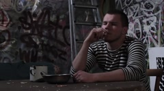 Prisoner smokes during a break Stock Footage