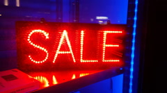 SALE led sign in shop store window Stock Footage
