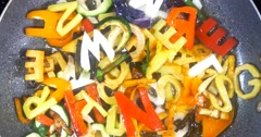 Stir-frying mixed alphabet letters vegetables Stock Footage