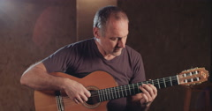 Musician playing an Acustic guitar in a recording studio Stock Footage