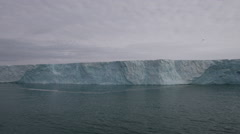 Slow motion approaching arctic glacier on ocean Stock Footage