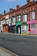 A street of derelict shops being sold by the council Stock Photos