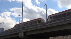 Tram traffic along the dedicated trestle ramp - stock footage