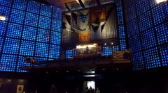 Large organ, blue glass, inside Kaiser Wilhelm Memorial Church, Berlin Stock Footage