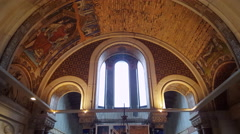 Ceiling tilt down information desk, Kaiser Wilhelm Memorial Church, Berlin Stock Footage