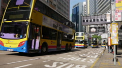 Cars and buses move along a busy road in Kowloon City District Stock Footage