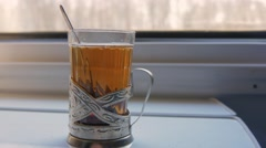 A glass of tea at the a train window Stock Footage