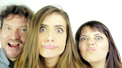 Beautiful people making funny crazy faces slow motion isolated Stock Footage