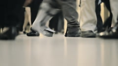 Legs feet people walking interior building anonymous crowd commute NYC Stock Footage