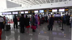 People line up a queue to check-in in the terminal 2 departure hall of Zhengzhou Stock Footage