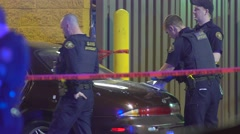 Police Investigating Gang Shooting With A Car Covered In Bullet Holes - stock footage