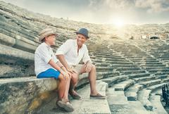 Father and son spent time together on antique ruins amphitheater Side,Turkey Stock Photos
