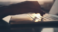 Female hands on laptop, close-up. RAW videorecord Stock Footage