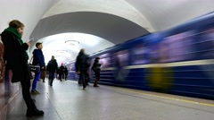 Underground metro station platform time lapse, people rush, train arrive, depart Stock Footage
