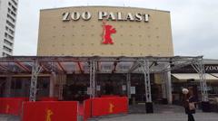 Outside of Zoo Palast theatre, Berlinale film festival, people walk, Berlin Stock Footage