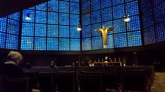 People pray, Golden Jesus statue, Kaiser Wilhelm Memorial Church, Berlin Stock Footage