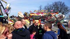 Stock Video Footage of Visitors in front of fairground attraction in funfair