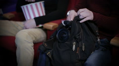 Pirating at the cinema, hidding camera in a bag Stock Footage
