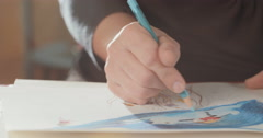 4K Close up shot of an artist drawing with colored pencil Stock Footage