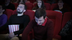 Young man pirating at the cinema Stock Footage