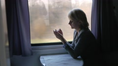 A woman uses a smartphone on the train Stock Footage