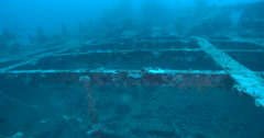 Ocean scenery along the deck level of WWII Japanese freighter, deck rusted or - stock footage