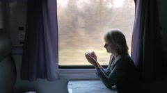 Always connected - woman enjoying a phone on the train - stock footage