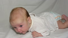 Baby lies on her stomach and lifts her head Stock Footage