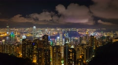 Time lapse of clouds over Hong Kong and Victoria Peak Harbor at night 4k movie - stock footage