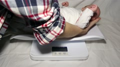 baby weighing - stock footage