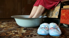 hot foot bath, relaxation and remedy for colds - stock footage