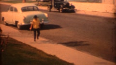 8mm Vintage, New RedCar leaving curb Stock Footage
