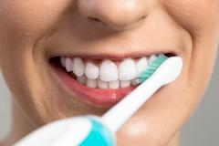 Cleaning and whitening teeth - stock photo