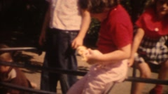 Stock Video Footage of 8mm Vintage, children at park on merry go round