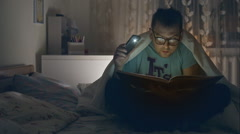 Adult man funny glasses reading book. Young guy reading book at home. RAW video Stock Footage