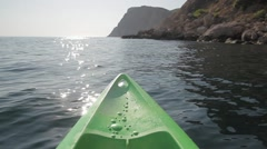 Green kayak or canoe crossing the sea Stock Footage